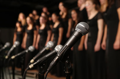Practice learning how to become a backup singer by joining a Choir